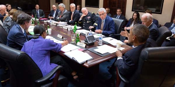 President Barack Obama and Vice President Joe Biden meet with members of the National Security Council in the Situation Room of the White House. Sept. 10, 2014.